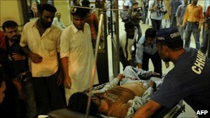 An injured man at a hospital in Karachi on August 4, 2010