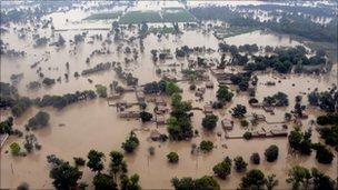 Houses are submerged in flood waters in Sanawan near Multan in central Pakistan