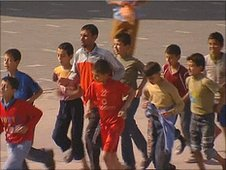 Nader runs with pupil at Beit Hanoun School