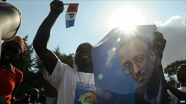 Rwandan Patriotic Front supporter carrying a poster of President Paul Kagame