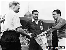 Hungary captain Ferenc Puskas (right) swaps pennants with England's Billy Wright