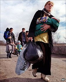 A Chechen woman fleeing the bombing in Grozny in 1999