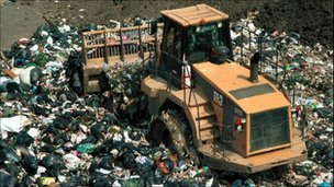 Tractor on landfill site