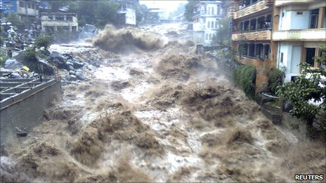 Floodwater tears through a town in north-west Pakistan (undated image from NGO Merlin)
