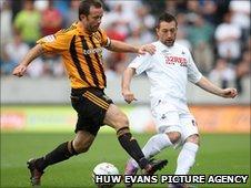 Hull's Ian Ashbee challenges Swansea's Stephen Dobbie