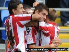Ched Evans celebrates his goal