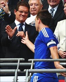 Fabio Capello commiserates with Chelsea's former England skipper John Terry