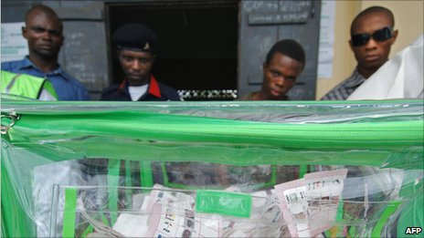 Four men stand behind a ballot box at a polling station in Bodo, Ogoni, Nigeria [14 April 2007]