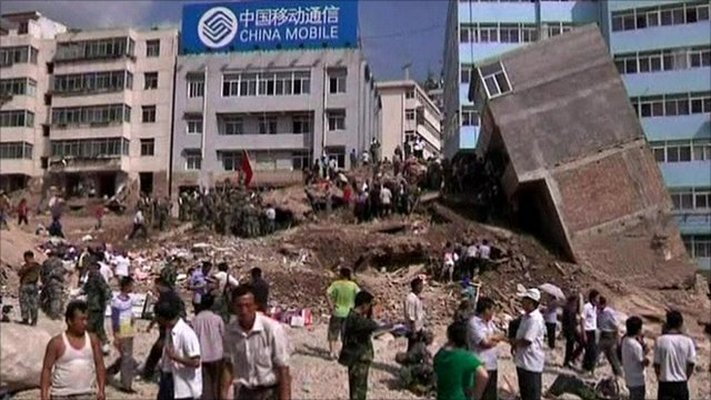 Building toppled by mudslide