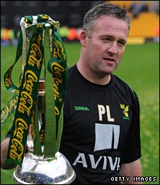 Paul Lambert with the League One trophy