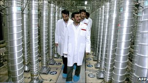 Iranian President Mahmoud Ahmadinejad walks past centrifuges at the Natanz uranium enrichment facilities (2008)