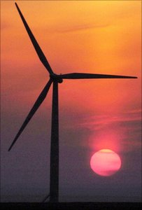 A wind turbine against a sunset sky in Scotland