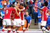 Jack Wilshere is mobbed by his Arsenal team-mates