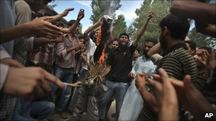Protesters burn an effigy of Chief Minister Omar Abdullah