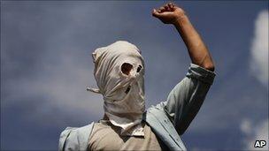 A masked Kashmiri Muslim protester