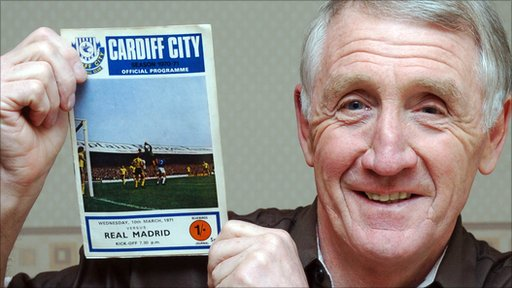 Brian Clark holding aloft the match programme from the Real Madrid game