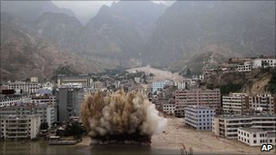 Explosives are set off to clear debris in Zhouqu, 10 August 2010