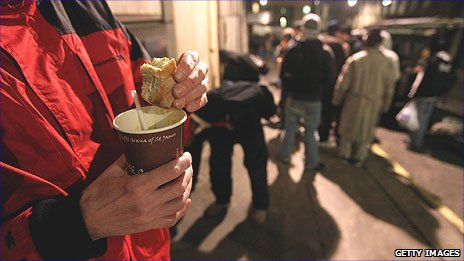 Homeless people being given food
