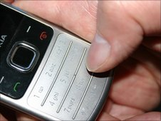 A person dialling 999 on a mobile phone