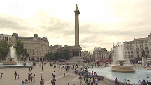Tourists visiting Trafalgar Square