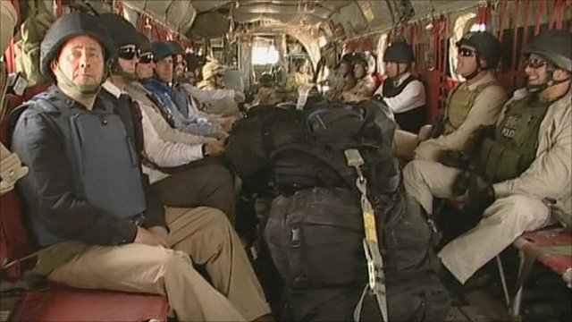 Liam Fox on plane with soldiers