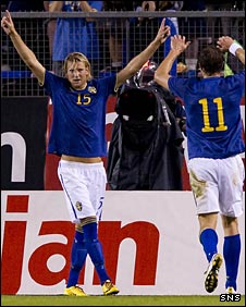 Ola Toivonen (left) celebrates Sweden's second goal in Stockholm