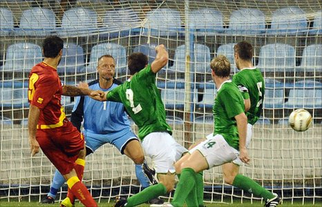Montenegro striker Mirko Vucinic shots just wide in Podgorica