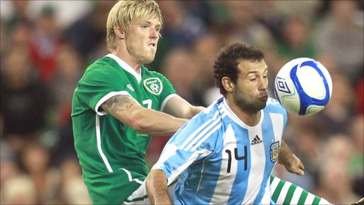 Republic of Ireland's Andy Keogh tackles Argentina's Javier Mascherano