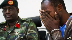 One of the suspects weeps at a press conference given by the Ugandan military on 12 August 12 2010