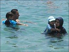 Muslim family in the sea