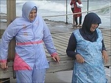 Muslim women wearing the burqini
