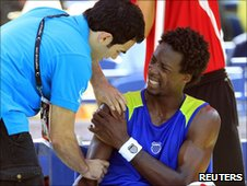 Gael Monfils is treated by the trainer