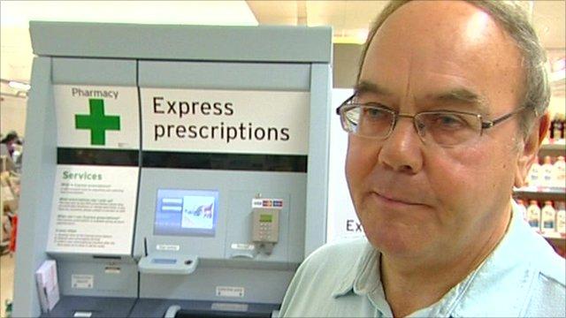 Roy Swift in front of prescription drug vending machine