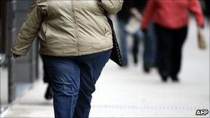 Obese woman walking down the street