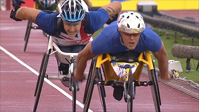 David Weir tries to find a way past Marcel Hug