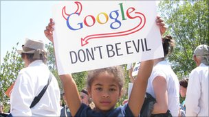 girl with Google don't be evil sign
