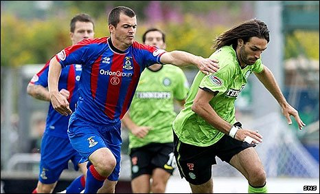 Russell Duncan tries to stay in touch with Georgios Samaras