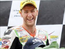 A delighted Ian Hutchinson on the podium after winning the opening Supersport race