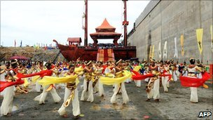 Sri Lankan dancers perform at the site of a new port under construction at the southern town of Hambantota, Sri Lanka 