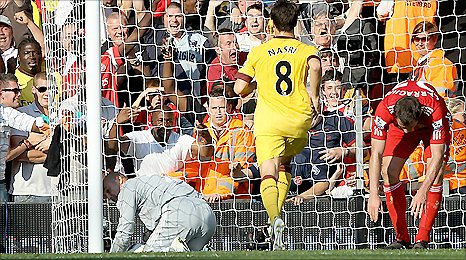 Liverpool keeper Pepe Reina (left) spills the ball into his own net