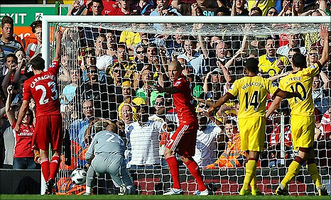 Liverpool keeper pepe Reina (in grey) fails to stop the ball going in as Arsenal equalise