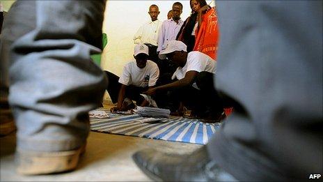 Rwandan electoral polling agents counting presidential ballots at Rugunga polling station in Kigali