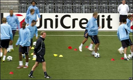 Tottenham boss Harry Redknapp with his players during a training session at the Stade de Suisse