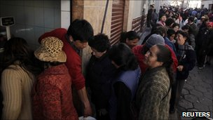 People queue in Potosi on 10 August 2010