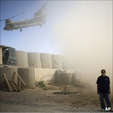 A US contractor guards an outpost