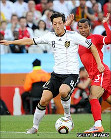Mesut Ozil storms past England's Ashley Cole at the World Cup
