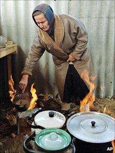 Woman cooking on wood-burning stoves (Image: AP)