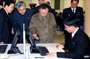 North Korean leader Kim Jong-il holding a computer's mouse