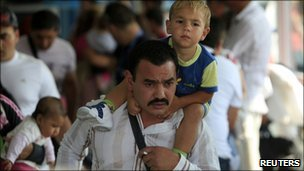 Roma families arriving at Bucharest airport, 19/08