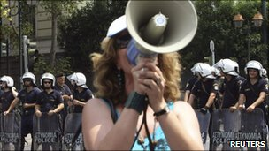 A protester shouts slogans during a rally in Athens